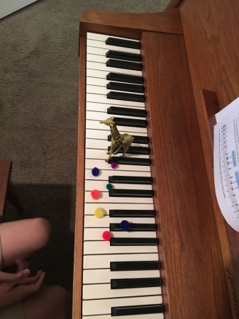 A giraffe and colorful fuzzies help with natural minor scales!