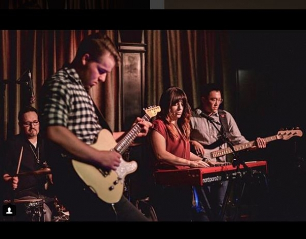 Full band. Photo by Justin Higuchi