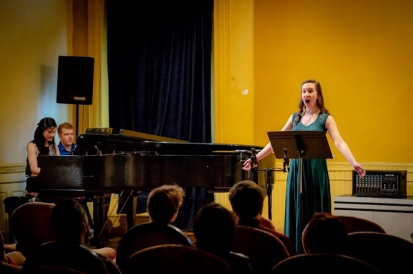 Singing a world premiere in All in the Sound: Songs on the Poetry of Whitman, Williams, and Stein