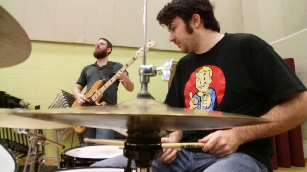 Playing bass in class back at Valencia College. I miss these days so much!