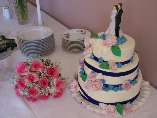 Did my own wedding cake. All flowers are handmade. Original design. Used white and green leaves.