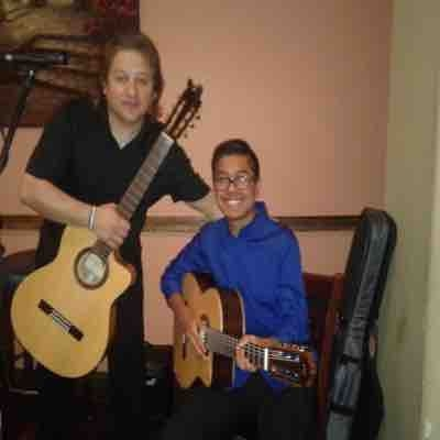 "Rick with Student Marcus Flamenco Guitar @""Student's Performance Night""."