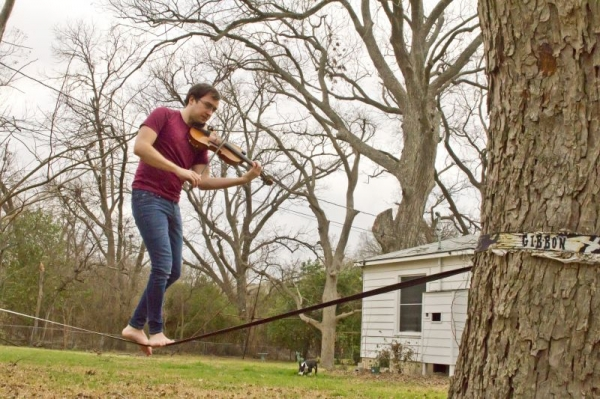 Slacklining while playing the violin.