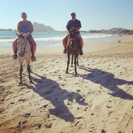 My husband and I riding horses in Mexico.