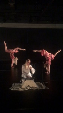 Orla performs a collaborative multimedia piece using her loop station with Fusion Dance Company