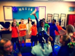 Students in class learning about music.