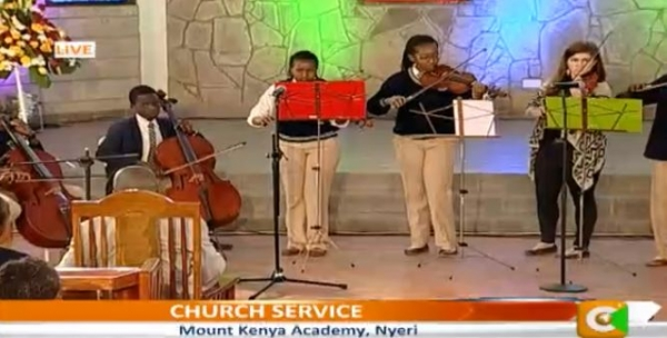 Performing with my high school orchestra (Pachelbel's Canon in D) during a concert that was broadcast on Kenyan National TV