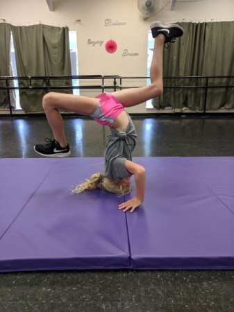 Student learning basics of breakdancing in a Hip Hop Summer Camp class.