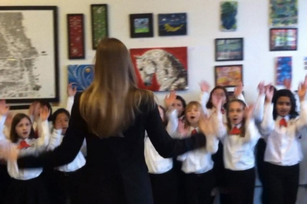 Directing a Chicago Children's Choir performance at a gallery