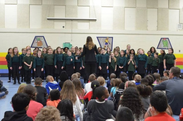 Leading choirs at a BHM Celebration Assembly in Michigan