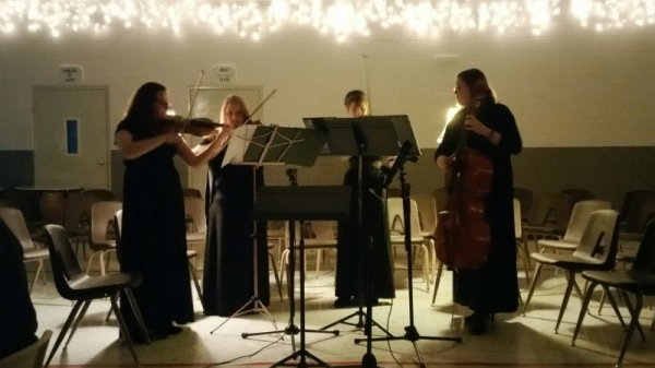 Me and my quartet playing at the annual Play and Sing His Praises Homeschool Orchestra fundraising banquet!