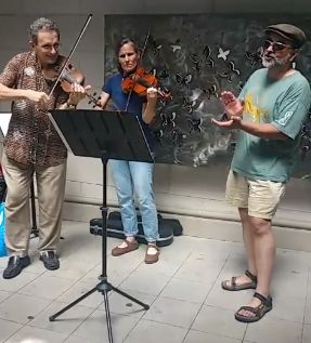 street busking Irish fiddle tunes with friends