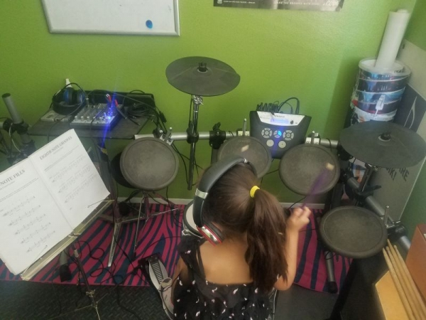 Learn to read music. Have fun playing the drums.