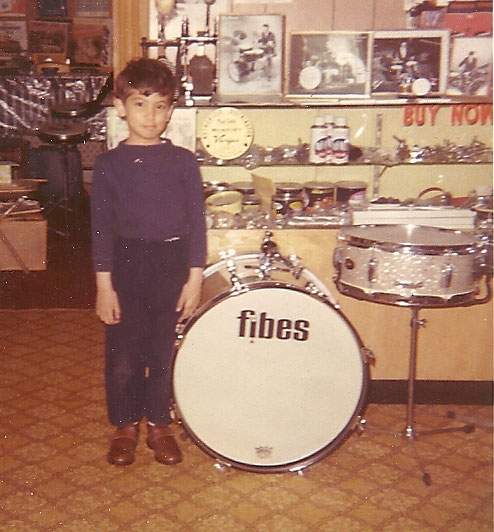 I went on to follow in my father's footsteps.. Here I am in his drum studio at just 5  years old! - Lou S. Drum Instructor.