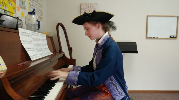 One of my piano students playing Pirates of the Carribean music in period garb.