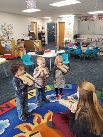 Pre-twinklers learning to hold the violin for the first time!