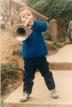 I started my musical journey from an early age through various instruments like the trumpet.
