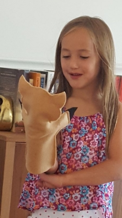 Helen experimenting with new words through Clive, the warthog puppet.