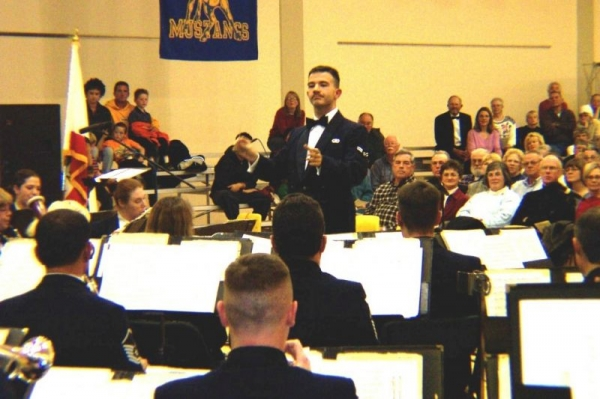 Conducting an original work with the US Air Force Band of the Golden West.