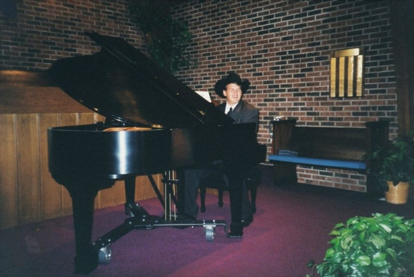 Playing piano at my very first wedding gig!  Nevermind the hat!!!