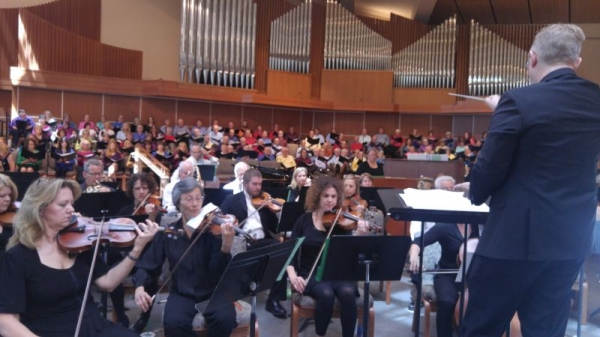 Conducting orchestra and choir for spring concert.
