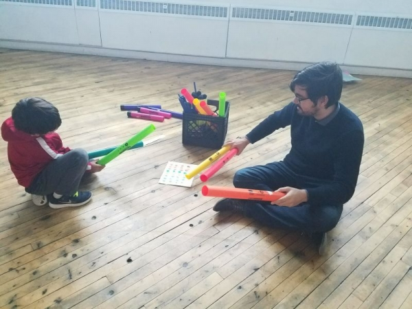 Working on a new composition with one of the students at the Cambridge Community Arts Center