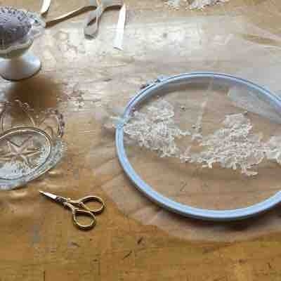 Hand beading onto Chantilly lace
