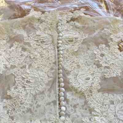 Finished bridal dress lace overlay with covered buttons