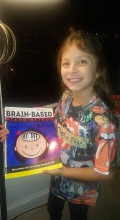 A proud student and her personalized book
