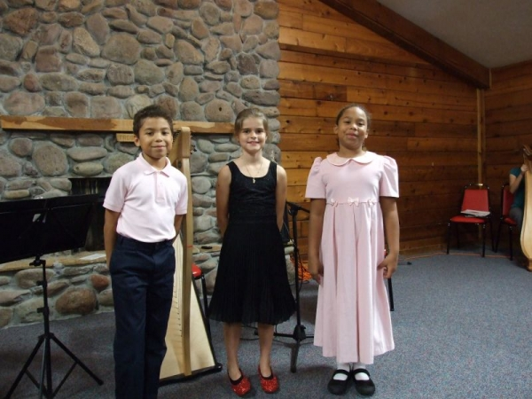 Proud students after successfully playing their trio piece at a recital!