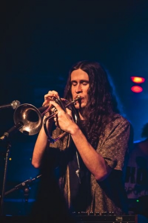 Playing a flugelhorn solo, live in Bloomington, IN (2018)