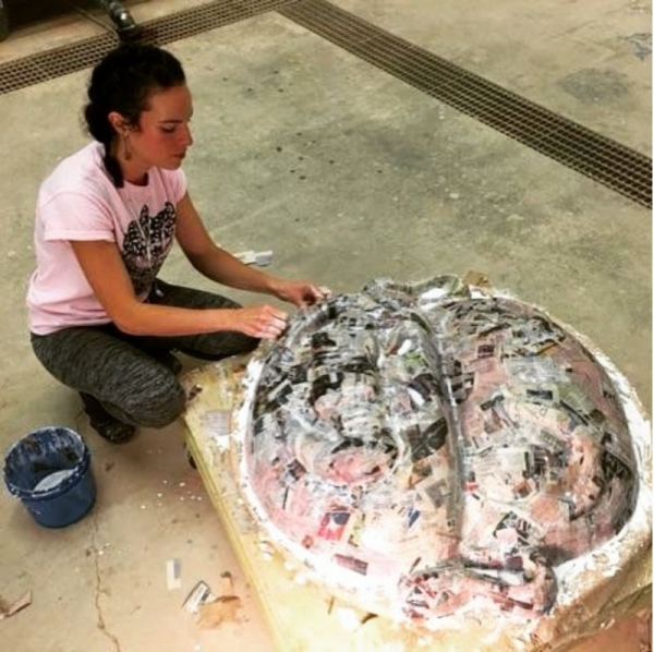This is a photo of a week-long demonstration of a paper maché mold I taught for a sculpture class at San Francisco Art Institute.