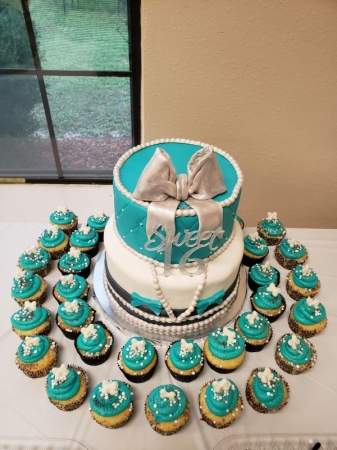 Sweet 16 birthday cake and cupcakes