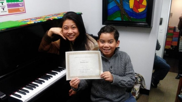 """Received """"Teacher of the Month"""" at Family Piano, so I decided to share that glory with one of my students."""