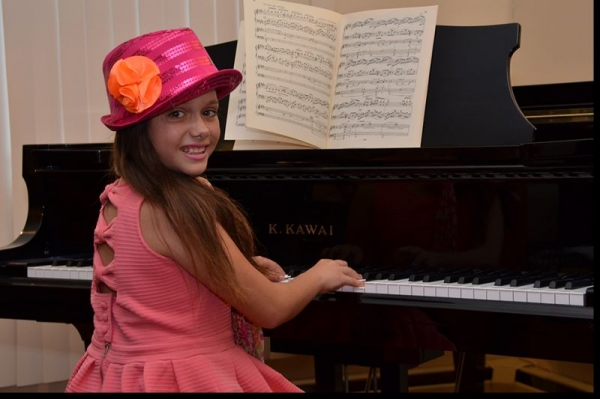 Learning music can be lots of fun! Student concert and costume party celebration at the private studio.