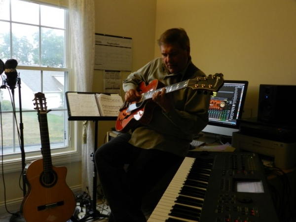In my home recording studio, playing an Eastman archtop jazz guitar.