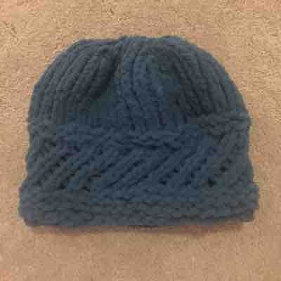 Bulky fuzzy hat. If you want to learn this please contact me. I would be delighted to teach you.
