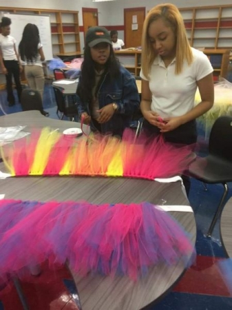 We went to a school and showed 20 students in a entrepreneur class how to make tutu's for profit in 1 hour.