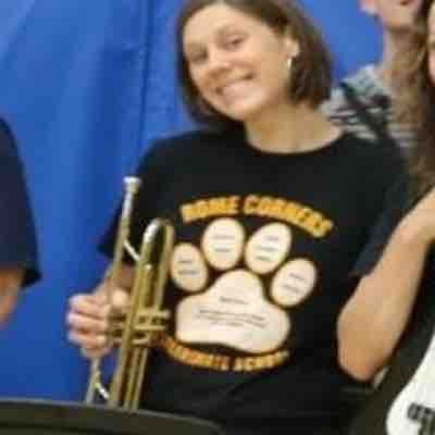 Playing trumpet in our school pep band.