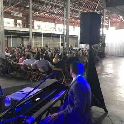 Playing a wedding with my lady in the John Deere Ag building at the Iowa State Fairgrounds.