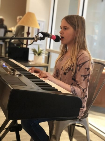 One of our lovely students performing at a showcase at The Portico in Downtown!