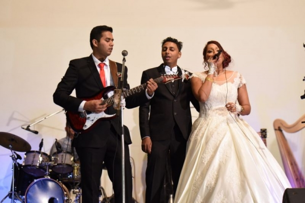 Playing in a wedding band.