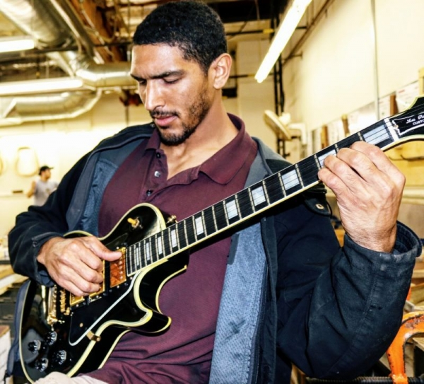 Playing a Gibson Black Beauty at Taylor guitar factory.