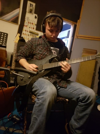 Laying down some heavy riffs and solo work for my friends studio album!