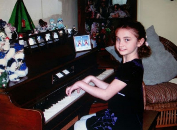 Younger me at the piano