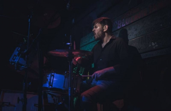 Performing with The Forum at a live show in Tampa, FL in 2018.