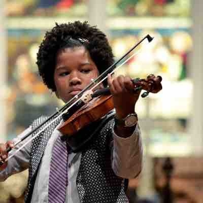 9 year old playing at a solo recital.  She was a beginner that year.