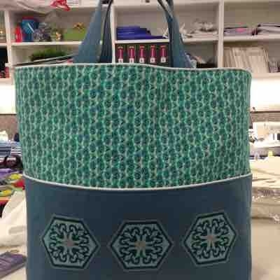 Machine embroidered then bag sewn.