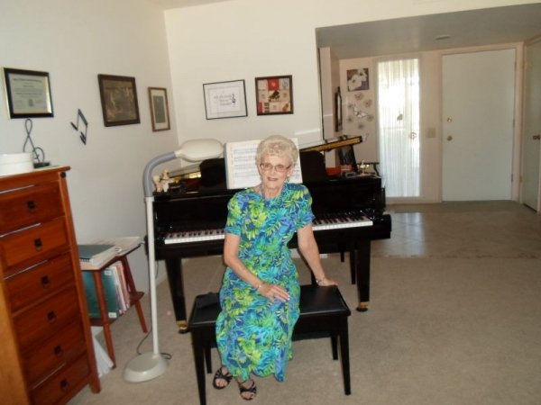 Mrs. Franke at home with her piano