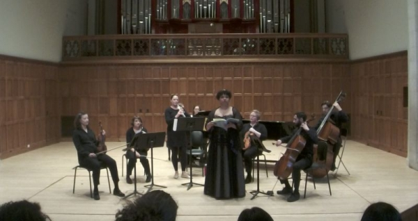 Singing at my senior recital with professional instrumentalists.